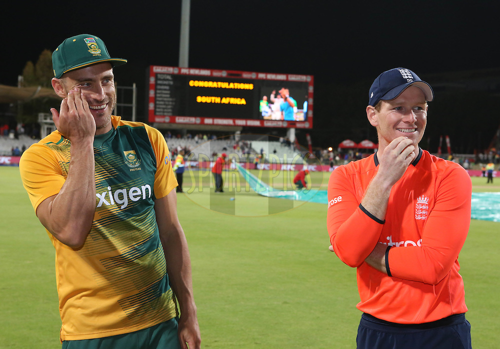 Far du Plessis and Eoin Morgan during the First KFC T20 Match between South Africa and England played at Newlands Stadium, Cape Town, South Africa on February 19th 2016