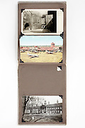 open photo album with postcards as memory of a vacation trip 1960