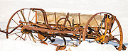 Agriculture, Old Farm Machinery, Plow Tiller in field coverd by snow in winter. Idaho