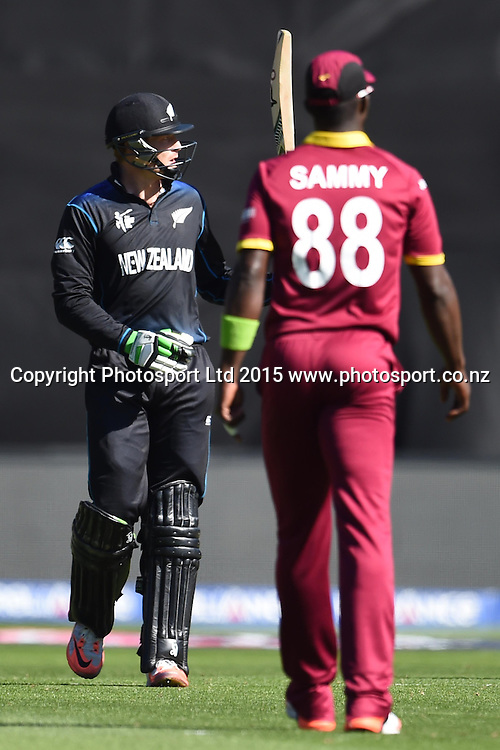 New Zealand batsman Martin Guptill celebrates his fifty during the ICC Cricket World Cup Quaterfinal match between New Zealand and West Indies at Westpac Stadium in Wellington, New Zealand. Saturday 21  March 2015. Copyright Photo: Raghavan Venugopal / www.photosport.co.nz