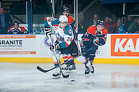KELOWNA, CANADA - FEBRUARY 6: Deven Sideroff #34 of Kamloops Blazers checks Leon Draisaitl #29 of Kelowna Rockets during first period on February 6, 2015 at Prospera Place in Kelowna, British Columbia, Canada.  (Photo by Marissa Baecker/Shoot the Breeze)  *** Local Caption *** Leon Draisaitl; Deven Sideroff;