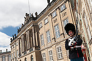 A Royal Guard standing on front of the Amalienborg Palace in Copenhagen.