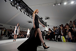 © London News PIctures. 13/09/2013. London, UK.  A model walks the runway at the Jean-Pierre Braganza show  at London Fashion Week Spring/Summer 2014. Photo credit: Ben Cawthra/LNP