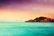 Long exposure a sunset on the beach of Cala Agulla, Mallorca, Spain - texturized photograph