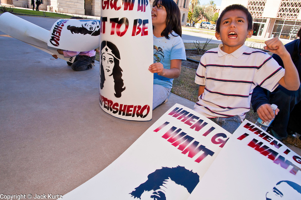 07 FEBRUARY 2011 - PHOENIX, AZ: KEVIN OLIVER, 8, from Phoenix, participates in a chant at the Arizona Capitol in support of birthright citizenship and the 14th Amendment Monday, February 7. The Arizona State Legislature, led by the State Senate is debating the 14th Amendment, which would bar US citizenship for the children of undocumented immigrants born in the United States. The bill has broad support among Republicans, who are the majority party, in the state legislature but not among Democrats. The law is also very unpopular in the state's Latino and immigrant communities.       Photo by Jack Kurtz