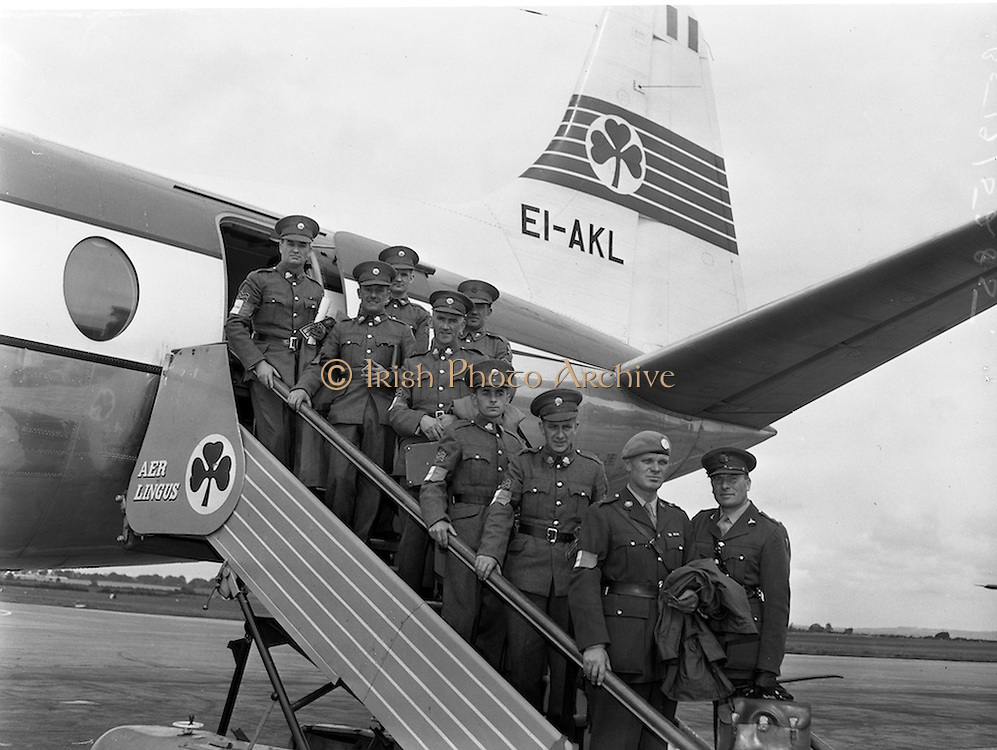 13/08/1960<br /> 08/13/1960<br /> 13 August 1960<br /> Advance party of the 33rd Battalion leaving Dublin Airport on an Aer Lingus Viscount for Paris en route to the Congo. The party of two officers and seven N.C.O.s would arrange the reception in the Congo for the main body of the 33rd which was due to fly out the next week. <br /> Picture shows Commandant Patrick Keogh (Limerick) (with UN beret); Quartermaster 33rd Battalion and Commandant Kevin O'Brien (Dublin) ad the seven N.C.O.s of the advance party boarding the Viscount plane.