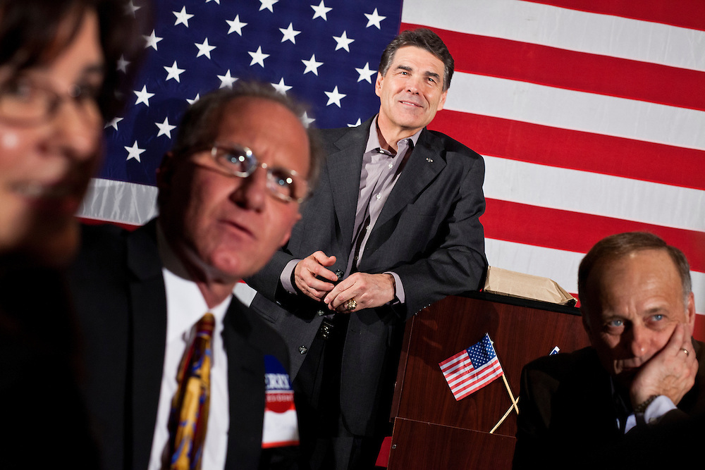 Republican presidential candidate Rick Perry takes a question at a Cerro Gordo County GOP Fundraiser on Friday, December 30, 2011 in Mason City, IA.