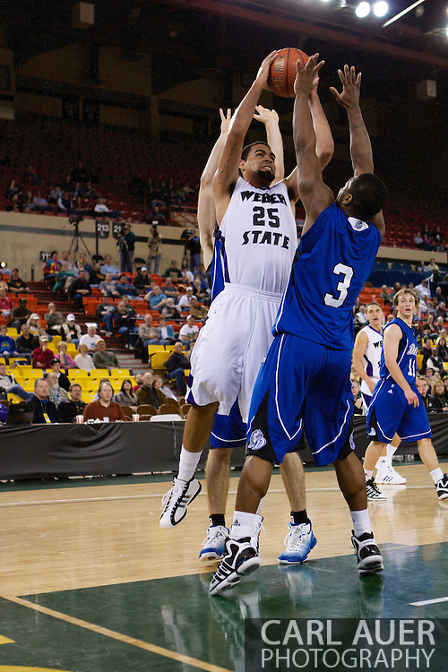 November 27th, 2010:  Anchorage, Alaska - Weber State freshman forward Byron Fulton (25) goes up for a shot in the Weber State 82-81 victory over the Drake Bulldogs in the third place game of the Great Alaska Shootout.