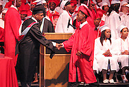 Graduates receive their diploma and handshake from principal Terry Logan during the Trotwood-Madison High School commencement at the Victoria Theatre in downtown Dayton, May 29, 2012.