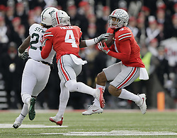 November 11, 2017 - Columbus, OH, USA - Ohio State Buckeyes safety Damon Webb (7) intercepts a pass intended for Michigan State Spartans wide receiver Darrell Stewart Jr. (25) behind cornerback Jordan Fuller (4) during the fourth quarter on Saturday, Nov. 11, 2017 at Ohio Stadium in Columbus, Ohio. (Credit Image: © Adam Cairns/TNS via ZUMA Wire)