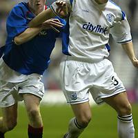 Rangers v St Johnstone....03.12.03<br />Ross Forsyth holds off Chris Burke<br /><br />Picture by Graeme Hart.<br />Copyright Perthshire Picture Agency<br />Tel: 01738 623350  Mobile: 07990 594431