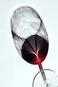 shadow of a wineglass with red wine
