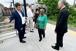 After departing the train Tropicana employee Renee Wilson, of Lindenwold, is one of the passengers helped with information about the upcoming temporary suspension for PTC installation on the Atlantic City Rail Line, at an information desk from NJ Transit, in Lindenwold, NJ, on Monday. (Bastiaan Slabbers for WHYY)