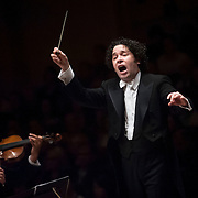 "December 12, 2012 - New York, NY : Conductor Gustavo Dudamel, on pedestal, leads the  Westminster Symphonic Choir (not visible) and the Simón Bolívar Symphony Orchestra of Venezuela as they perform Heitor Villa-Lobos's ""Chôros No.10"" at Carnegie Hall's Stern Auditorium / Perelman Stage on Tuesday evening.  CREDIT: Karsten Moran for The New York Times"