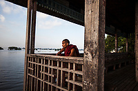 A young monk outside of Mandalay in Myanmar.