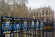 On the day that Theresa May meets with her cabinet to prepare for a No Deal Brexit, the faces of leading and controversial cross-party politicians involved in Brexit issues have been attached to railings opposite parliament in Westminster by protestors, on 2nd march 2019, in London, England. From left to right: Nigel Farage, Jacob Rees-Mogg, Chris Grayling, Jeremy Corbyn, Prime Minister Theresa May and Boris Johnson.