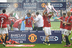 WIGAN, ENGLAND - Sunday, May 11, 2008: Manchester United's Carlos Tevez and Owen Hargreaves celebrate after winning the Premier League for the 10th time after the final Premiership match of the season at the JJB Stadium. (Photo by David Rawcliffe/Propaganda)