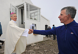 Papal Nuncio, Archbishop Charles Brown meeting pilgrims on the summit of Croagh Patrick after he celebrated mass during the annual pilgrimage which took place yesterday. <br /> Pic Conor McKeown