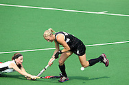 Emily Naylor is beaten to the ball by Emma Batten of Wales during the pool B women's hockey match of the The Commonwealth Games between New Zealand and Wales held at the Stadium in New Delhi, India on the  October 2010..Photo by:  Ron Gaunt/SPORTZPICS/PHOTOSPORT