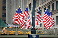 Flags fluttering outside Grand Central Station, Manhattan, New York. Picture date: Saturday September 10, 2016.<br /> Photograph by Christopher Ison &copy;<br /> 07544044177<br /> chris@christopherison.com<br /> www.christopherison.com<br /> Image provided to Cunard Line PR Department for unlimited global use.