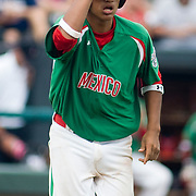 8/22/10 Aberdeen, MD: Mexico catcher Marco Santa Cruz (13) take first base after drawing a walk at The Cal Ripken World Series in Aberdeen MD. Credit: Saquan Stimpson/ Southcreek Global