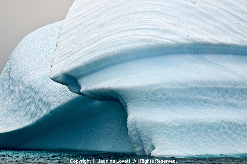 curved groved craved the ocean into this iceberg.