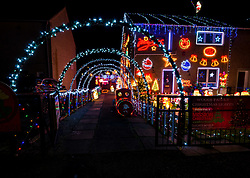 Prestonpans, East Lothian, Scotland, United Kingdom, 9th December 2019. Christmas decorations around the villages. Locals decorate their houses with a variety of lights and Christmas decorations. The Woods family in Prestonpans use more than 10,000 lights to decorate their home each year to raise money for Mission Christmas and Cash for Kids.<br /> Sally Anderson | EdinburghElitemedia.co.uk