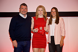 NEWPORT, WALES - Saturday, May 19, 2018: Lucy Attwood is presented with her Under-16's cap by Osian Roberts (left) and Lauren Dykes (right) during the Football Association of Wales Under-16's Caps Presentation at the Celtic Manor Resort. (Pic by David Rawcliffe/Propaganda)