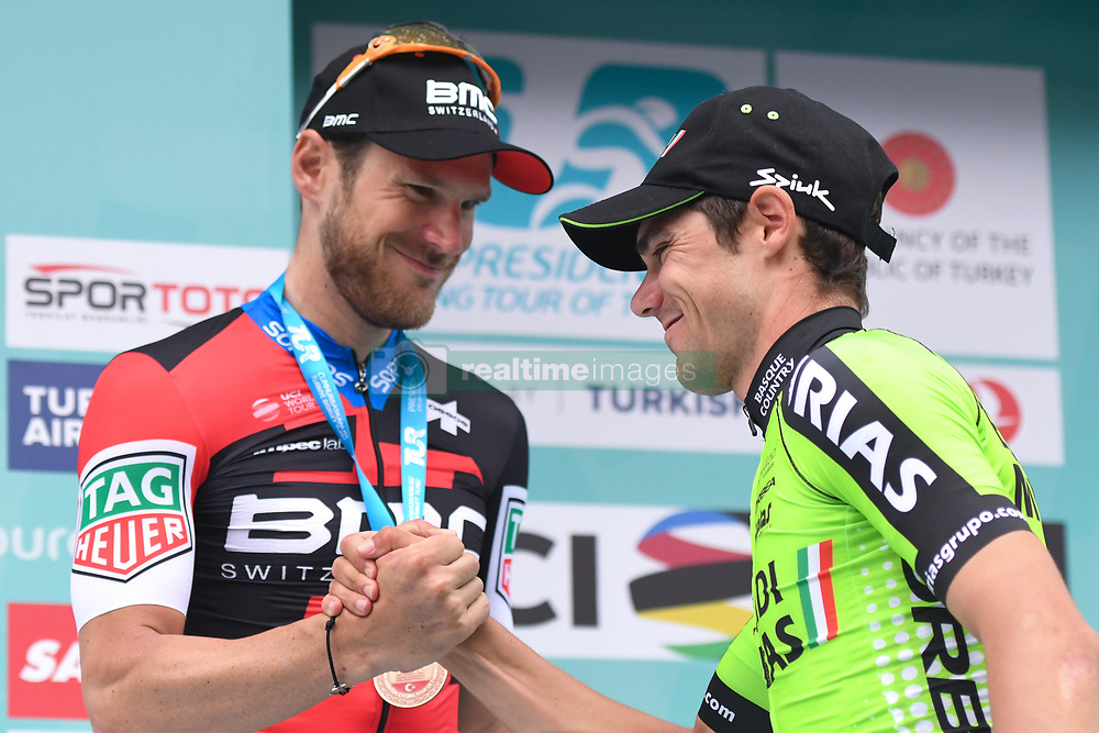 October 14, 2018 - Istanbul, Turkey - Eduard Prades Reverter (Right) of Spain and Euskadi Basque Country-Murias receices congratulations from Jean-Pierre Drucker of Luxembourg and BMC Racing Team, after finishing second the sixth stage and winning the general classification of the 54th Presidential Cycling Tour of Turkey 2018. .On Sunday, October 14, 2018, in Istanbul, Turkey. (Credit Image: © Artur Widak/NurPhoto via ZUMA Press)