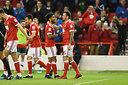 Nottingham Forest forward Lee Tomlin (15) celebrates with Nottingham Forest midfielder Liam Bridcutt (7) after scoring a goal to make it 1-0 during the EFL Sky Bet Championship match between Nottingham Forest and Barnsley at the City Ground, Nottingham, England on 24 April 2018. Picture by Jon Hobley.