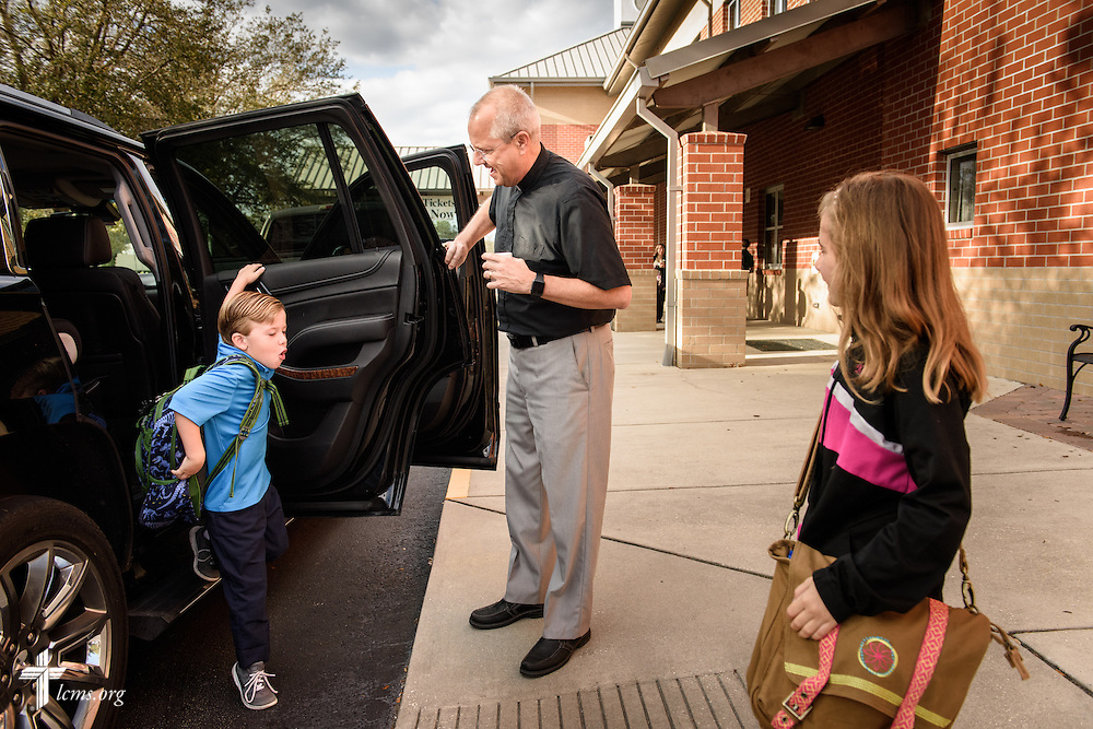 The Rev. Wally Arp, senior pastor at St. Luke's Lutheran Church, helps children as they arrive to the parish school on Monday, March 7, 2016, in Oviedo, Fla. LCMS Communications/Erik M. Lunsford