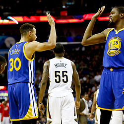 Dec 13, 2016; New Orleans, LA, USA;  Golden State Warriors guard Stephen Curry (30) high fives forward Kevin Durant (35) during the second half of a game against the New Orleans Pelicans at the Smoothie King Center. The Warriors defeated the Pelicans 113-109. Mandatory Credit: Derick E. Hingle-USA TODAY Sports