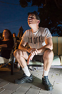 "Merrick, New York, USA. 11th June 2017.  CHRIS EDOM, ""American Grit"" TV series contestant, 48, of Merrick, wears GOT GRIT? T-shirt as he sits in his backyard with family, friends, neighbors, athis Viewing Party for Season 2 premiere of the FOX network reality television series."
