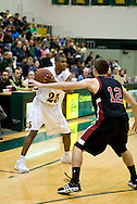 1/6/2006: Senior guard Eric Draper (25) of the UAA Seawolves looks for a open teammate while Johnny Spevak of the Central Washington Wildcats plays defense. Anchorage would go on to beat the visiting Central Washington Wildcats, 80-60 at the Wells Fargo Sports Complex on the campus of UAA.<br />
