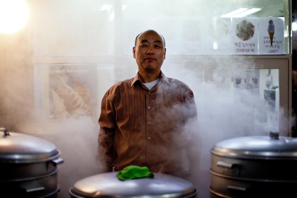 "Portrait of a man selling Korean traditional ""Mandu"" dumplings close to Sangdo subway station in Seoul."