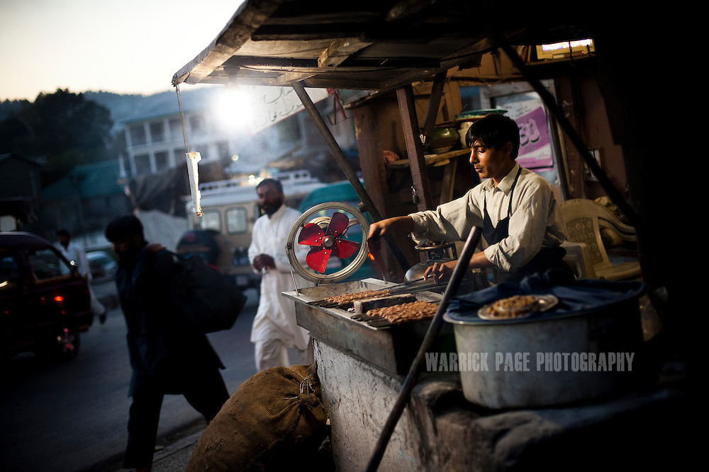 A roadside BBQ cook, prepares kebab for customers on May 8, 2011 in Abbottabad, Pakistan. The town of Abbottabad became infamous after the US launched a midnight raid on a compound housing Osama bin Laden in the garrison town, on May 2, 2011. The operation, code-named Operation Neptune Spear, was launched from neighbouring Afghanistan and resulted in the killing of one of the world's most notorious terrorists and who claimed responsibility for the 9/11 attacks in the US. U.S. forces took bin Laden's body to Afghanistan for identification, then dumped it the Arabian Sea. Pakistan has since been widely suspected as having prior knowledge of his whereabouts as the compound was less than a kilometre from the country's biggest military academy. (Photo by Warrick Page)