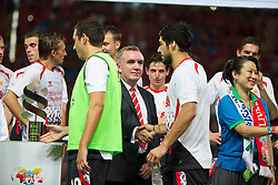 BANGKOK, THAILAND - Sunday, July 28, 2013: Liverpool's Managing Director Ian Ayre shakes hands with Luis Suarez after a preseason friendly match against Thailand XI at the Rajamangala National Stadium. (Pic by David Rawcliffe/Propaganda)