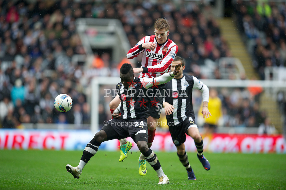 NEWCASTLE, ENGLAND - Sunday, March 4, 2012: Newcastle United's Cheick Tiote in action against Sunderland's Nicklas Bendtner during the Premiership match at St. James' Park. (Pic by David Rawcliffe/Propaganda)