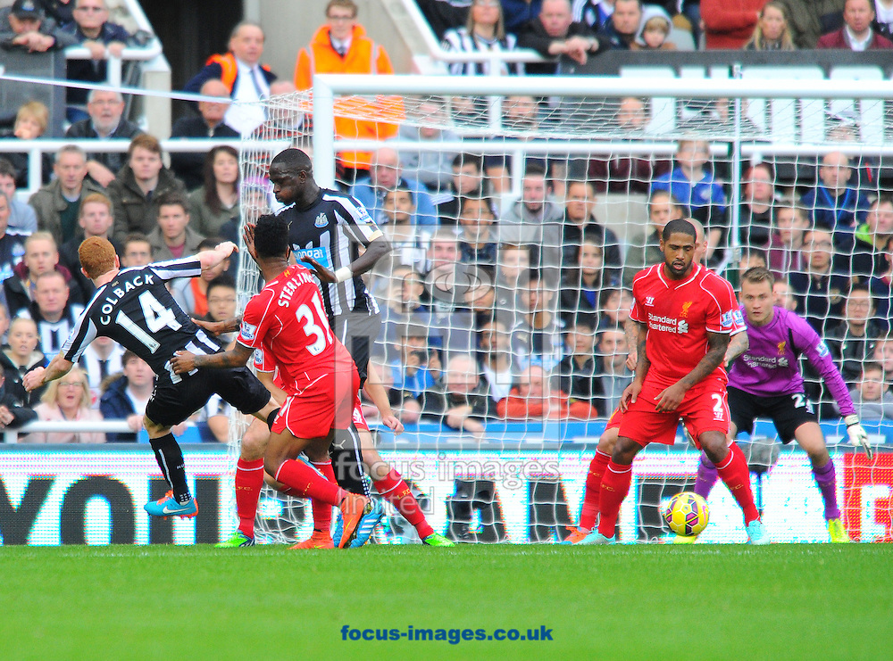 Jack Colback of Newcastle United (left) shoots but misses a chance during the Barclays Premier League match at St. James's Park, Newcastle<br /> Picture by Greg Kwasnik/Focus Images Ltd +44 7902 021456<br /> 01/11/2014