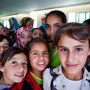 Children in a Mercy Corps adolescent friendly space, a few weeks after the opening of Azraq camp for Syrian refugees, Jordan, May 2014.