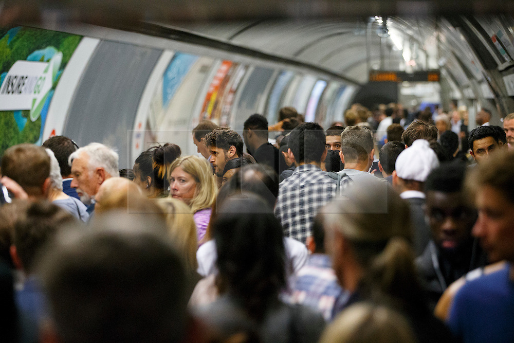 © Licensed to London News Pictures. 05/08/2015. London, UK. Commuters queuing for tube trains at Bank tube station ahead of the Tube strike in the evening rush hour of Wednesday, August 5, 2015. The strike will be a 27-hour stoppage by about 20,000 Tube staff to shut down the entire London Underground network on the second strike over night `service on parts of Tube, which will be starting on 12 September 2015. Photo credit: Tolga Akmen/LNP