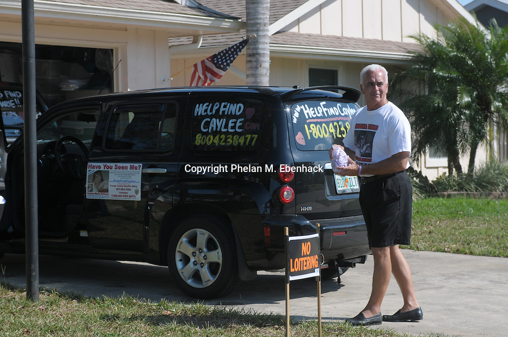George Anthony, grandfather of missing three-year-old Caylee Anthony stands outside his car in Orlando, Florida, while talking to supporters after Caylee's mother, Casey Anthony, returned from her attorney's office, Friday, September 26, 2008.