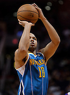 Apr 7, 2013; Phoenix, AZ, USA; New Orleans Hornets guard Eric Gordon (10) shoots a free throw against the Phoenix Suns in the second half at US Airways Center. The Hornets defeated the Suns 95-92. Mandatory Credit: Jennifer Stewart-USA TODAY Sports