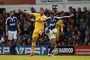 MK Dons forward Dean Bowditch (9)  challenges Ipswich Town midfielder Kevin Bru (17)  during the Sky Bet Championship match between Ipswich Town and Milton Keynes Dons at Portman Road, Ipswich, England on 30 April 2016. Photo by Simon Davies.