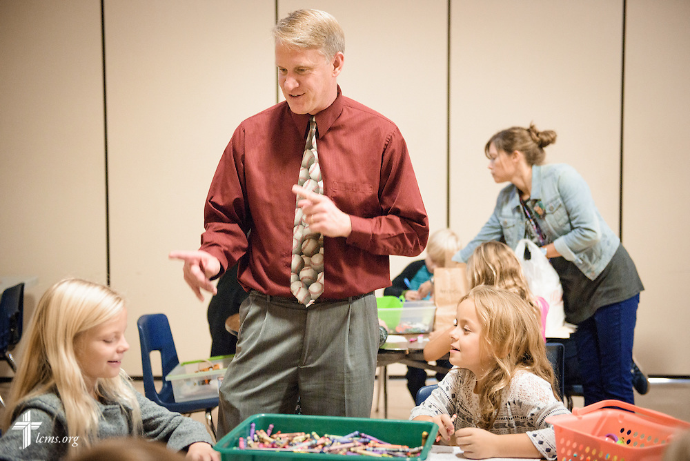 The Rev. Tim Seban, associate pastor of First Immanuel Lutheran church, visits with students during a Reformation Day celebration classroom activity on Friday, Oct. 28, 2016, at First Immanuel Lutheran School in Cedarburg, Wis. LCMS Communications/Erik M. Lunsford