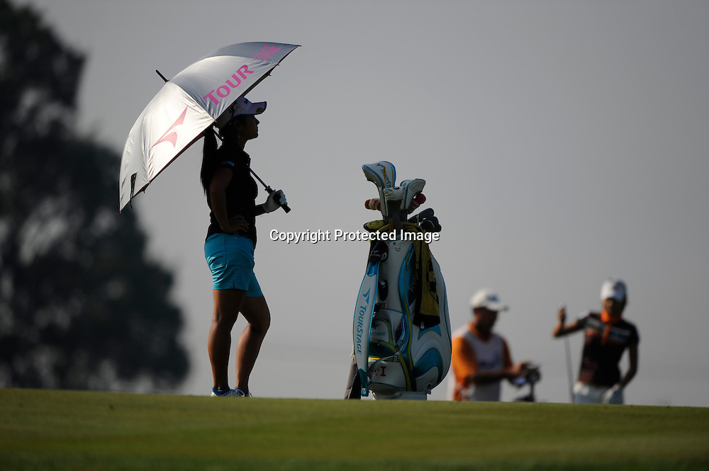 Ai Miyazato waits to play from the fairway during a practice round for the Women's U.S. Open Golf Championship in Oakmont, Pennsylvania.