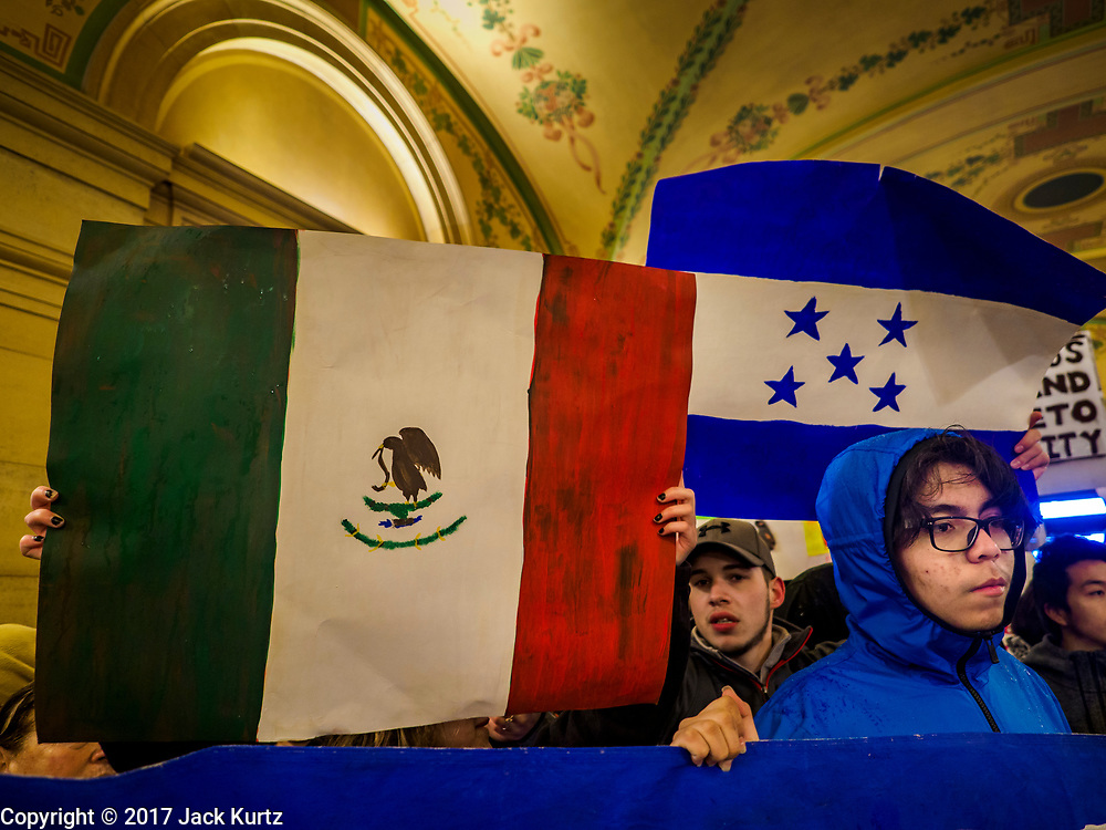 01 MAY 2017 - ST. PAUL, MN: Immigrants' rights activists hold up the flags of Mexico (left) and Honduras (right) during a May Day immigrants' rights march in the Minnesota State Capitol. About 300 people, representing immigrants' and workers' rights organizations, marched through the Minnesota State Capitol during a demonstration to mark May Day, International Workers' Day.      PHOTO BY JACK KURTZ