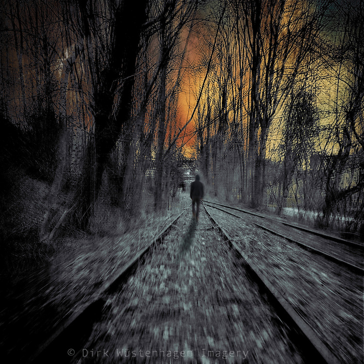 Surreal scenery with a man walking on railway tracks &ndash; manipulated photograph<br />