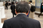 graying middle aged businessman seen from behind