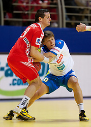 Ivan Nincevic of Croatia vs Jure Dolenec of Slovenia during handball match between Slovenia and Croatia in  2nd Round of Preliminary Round of 10th EHF European Handball Championship Serbia 2012, on January 18, 2012 in Millennium Center, Vrsac, Serbia. Croatia defeated Slovenia 31-29. (Photo By Vid Ponikvar / Sportida.com)